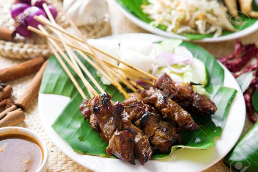20891461-satay-or-sate-skewered-and-grilled-meat-served-with-peanut-sauce-cucumber-and-ketupat-malaysia-or-in-stock-photo