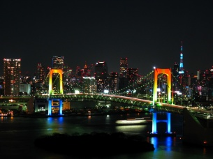Rainbow_colored_Rainbow_Bridge_at_night